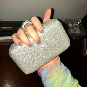 Silver glitter clutch with ring